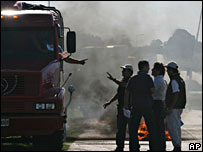 Truck driver argues with farmers blocking a road in Tandil, Argentina on 26 March