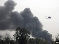 A plume of smoke rises above Baghdad's Green Zone