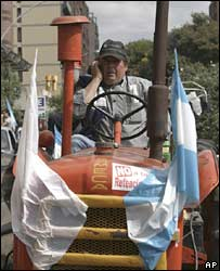 farmer drives his tractor during a protest in Cordoba, Argentina, on 26 March