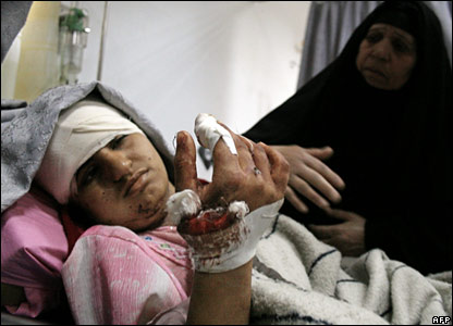 A woman comforts a wounded relative at a hospital in Baghdad's Shia district of Sadr City.