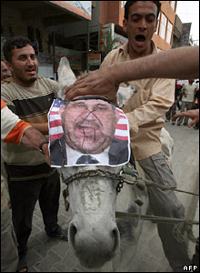 Sadrists place the picture of Iraqi PM Nouri Maliki on the head of a donkey during a demonstration in Baghdad.