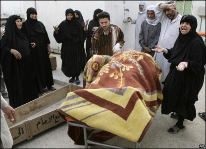 Iraqis mourn during a funeral after a mortar hit a home killing three people in Sadr City, Baghdad.