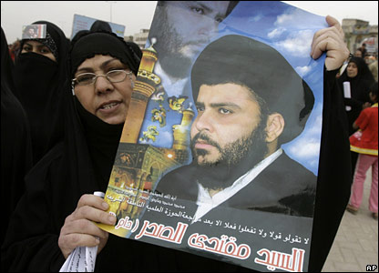 A Shia woman holds poster of radical Moqtada Sadr during a protest in Sadr City.