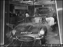 E-type Jaguar in a car wash