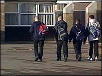 groups of boys walking into school
