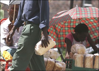 A man with a loaf of bread bought from a black market dealer on 26 March 2008
