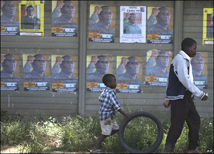 Campaign posters of Robert Mugabe in Harare on 26 March 2008