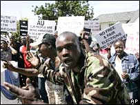 Zimbabwe's Movement for Democratic Change supporters demonstrate outside their embassy in Pretoria