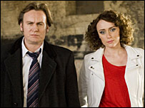 DCI Gene Hunt (Philip Glenister) with DI Alex Drake (Keeley Hawes)