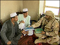 Afghan villagers with UAE troops