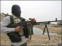Mehdi Army fighter with a machine gun in Basra on 28 March 2008