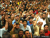 Moqtada Sadr's supporters at a Friday prayer service in Sadr City, Baghdad, on 28 March 2008