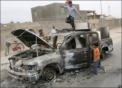 A government car destroyed in fighting with the Mehdi Army in Basra, 28 March 2008