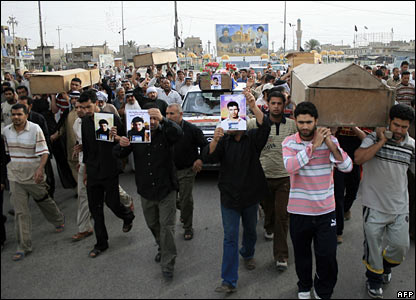 Iraqis carry the coffins of relatives at a mass funeral in Sadr City, Baghdad, 28 March 2008