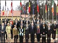 EU Foreign Ministers pose for a group photo during the informal EU foreign ministers meeting in Brdo