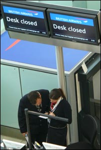 Two British Airways check-in staff