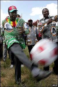 President Mugabe kicks a ball at his final rally on Friday