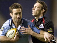 Cardiff's Jason Spice is tackled by rival scrum-half Mike Blair