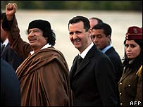 Syrian President Bashar al-Assad (centre) greets Libyan leader Muammar Gaddafi on 28 March ahead of the summit