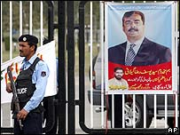 A poster of Pakistan's new Prime Minister, Yusuf Raza Gillani, hangs outside parliament in Islamabad
