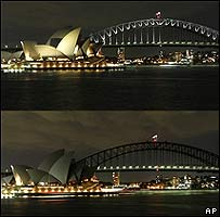 Sydney skyline before (top) and after (bottom) switching off on 29 March