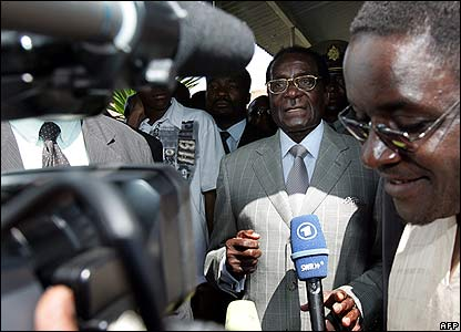 Media surround Robert Mugabe after he votes in Harare