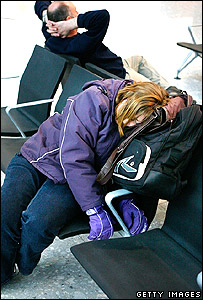 Woman passenger sleeping at Heathrow