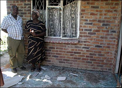 Aspiring MP Judith Mkwanda tells a neighbour how her house was petrol-bombed
