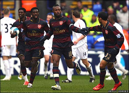 Adebayor, Gallas, and Walcott celebrate for Arsenal