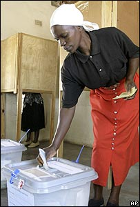 Woman votes at polling station in Harare, Zimbabwe