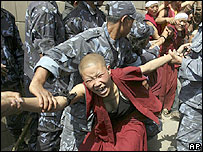 Police drag away Tibetan nuns outside the Visa section of Chinese Embassy in Kathmandu, Nepal