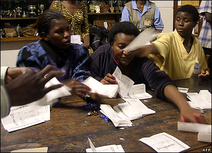 Electoral commission workers count votes in Harare on 30 March
