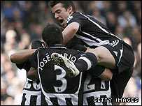 Newcastle celebrate during their victory at White Hart Lane