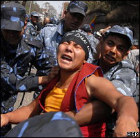 A Buddhist monk is arrested by Nepalese police outside the Chinese embassy (30 March 2008)