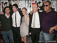 The director and cast of 21