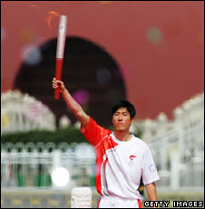 Chinese sporting icon Liu Xiang holding the torch (31st March)
