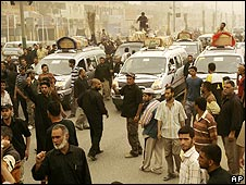 Funerals are held in Sadr City on 31 March after Baghdad lifts its curfew
