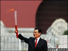 Hu Jintao holding the torch at the ceremony