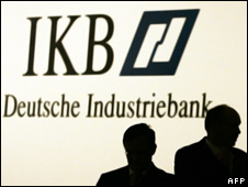 People against an IKB sign