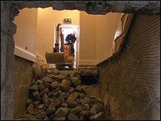 Digger excavating at Haut de la Garenne