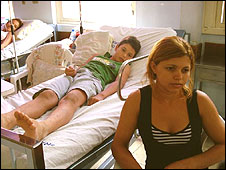 Tania Maria Mocinho da Silva with her sick son, Anderson, in hospital in Rio, March 2008