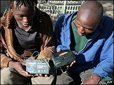 Zimbabweans listen to the radio for results