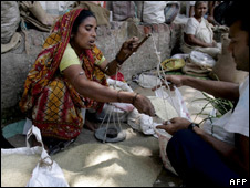 A woman selling rice in Calcutta