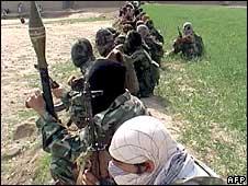Pakistani Taliban militants gather during a public rally in Inayat Kili