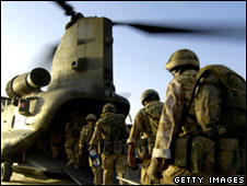 Soldiers board an RAF Chinook in August 2005