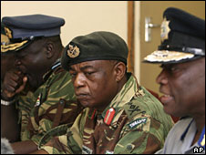 Commissioner general of the Zimbabwe police, Augustine Chihuri, right, addresses a press conference, as the Commander of the Zimbabwe Defence Forces, Constantine Chiwenga, second from right, Air Force chief Perence Shiri