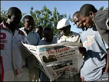 Zimbabweans in Harare read a local newspaper