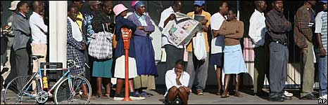 People in a line to buy food in Zimbabwe