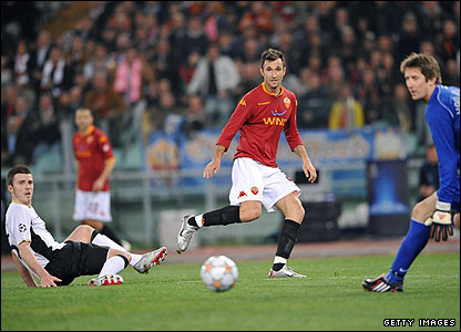 Roma's Mirko Vucinic drags his shot wide