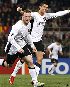 Wayne Rooney and Cristiano Ronaldo celebrate at the Stadio Olimpico